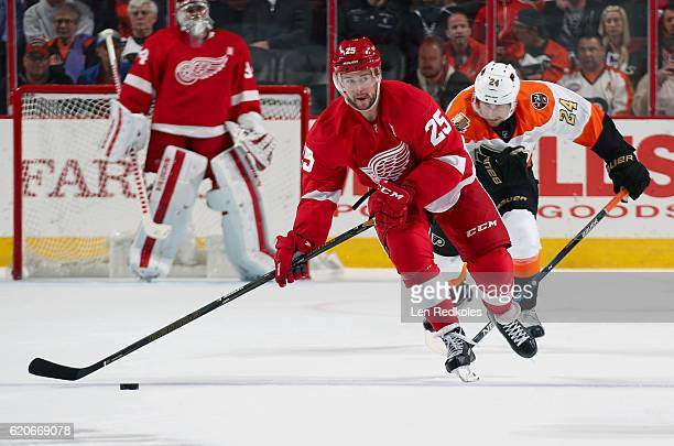 Mike Green of the Detroit Red Wings looks to make a pass while Matt Read of the Philadelphia Flyers pursues him on November 2 2016 at the Wells Fargo...