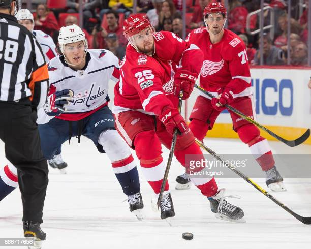Mike Green of the Detroit Red Wings passes the puck in front of TJ Oshie of the Washington Capitals during an NHL game at Little Caesars Arena on...