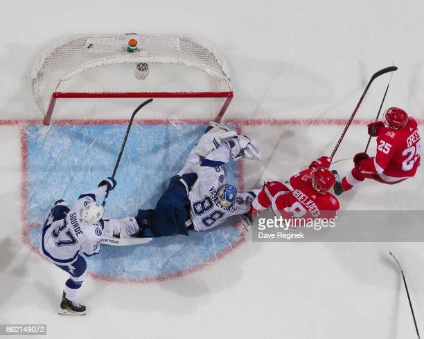 Mike Green of the Detroit Red Wings scores a second period goal as teammate Justin Abdelkader screens goaltender Andrei Vasilevskiy of the Tampa Bay...