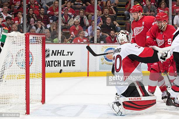 Mike Green of the Detroit Red Wings scores his second goal of the first period on goaltender Andrew Hammond of the Ottawa Senators during an NHL game...