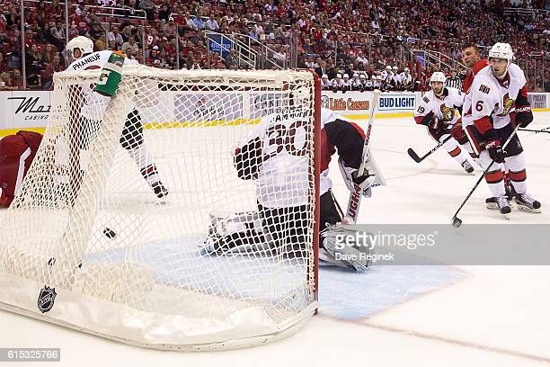Mike Green of the Detroit Red Wings scores his third goal of the game in the third period on goaltender Andrew Hammond of the Ottawa Senators during...