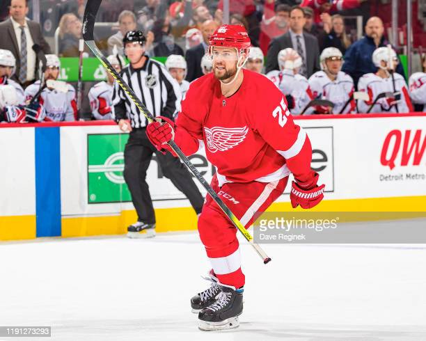 Mike Green of the Detroit Red Wings skates in after teammate Luke Glendening of the Detroit Red Wings scores a third period goal against the...