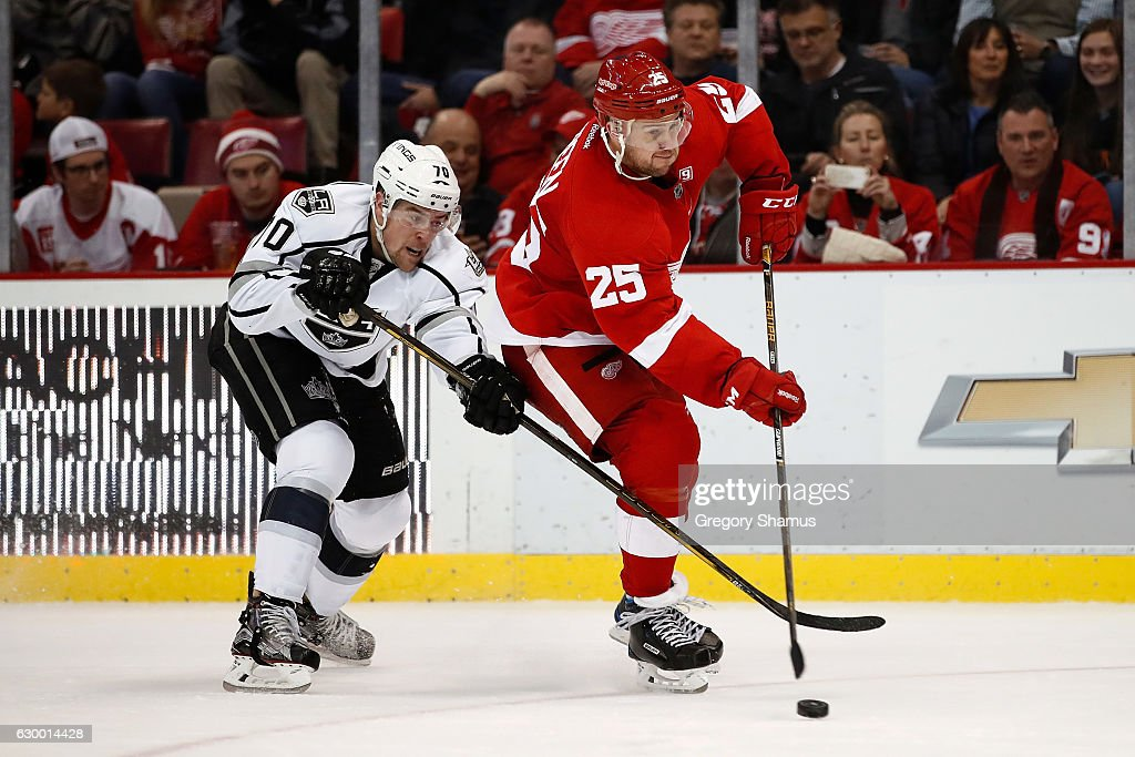 Mike Green #25 of the Detroit Red Wings tries to avoid the stick of Tanner Pearson #70 of the Los Angeles Kings at Joe Louis Arena on December 15, 2016 in Detroit, Michigan. Los Angeles won the game 4-1.