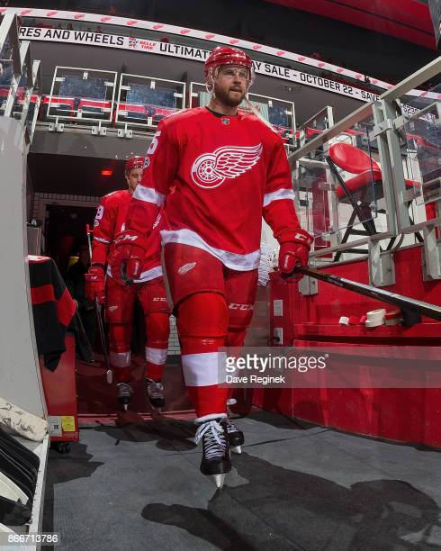 Mike Green of the Detroit Red Wings walks out to the ice for warm ups before an NHL game against the Washington Capitals at Little Caesars Arena on...