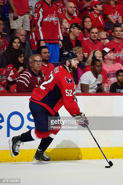 Mike Green of the Washington Capitals controls the puck against the New York Rangers during the third period in Game Six of the Eastern Conference...