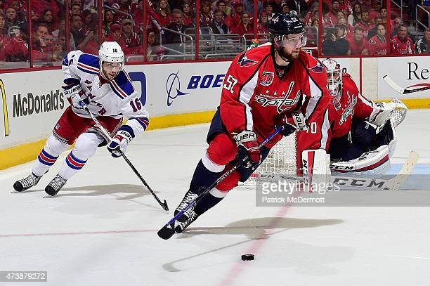 Mike Green of the Washington Capitals controls the puck against the New York Rangers during the third period in Game Four of the Eastern Conference...
