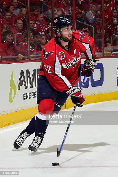 Mike Green of the Washington Capitals controls the puck during the first period against the New York Islanders in Game Two of the Eastern Conference...