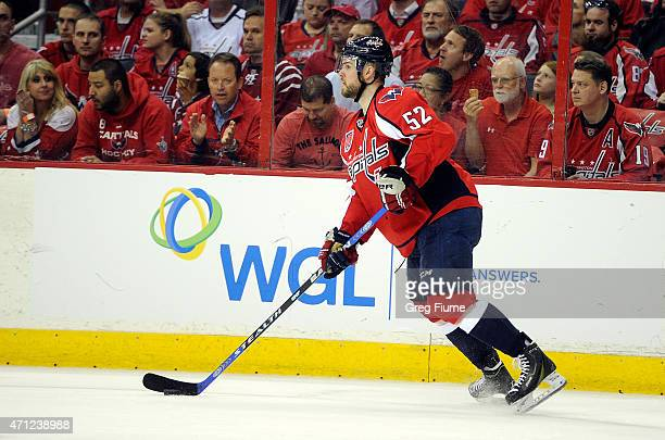 Mike Green of the Washington Capitals handles the puck against the New York Islanders during Game Two of the Eastern Conference Quarterfinals during...