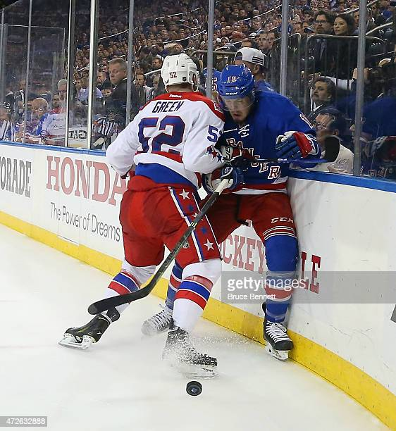 Mike Green of the Washington Capitals hits JT Miller of the New York  Rangers into the 0569b5dd7