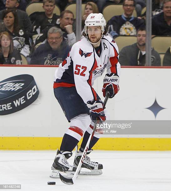 Mike Green of the Washington Capitals skates against the Pittsburgh Penguins during the game at Consol Energy Center on February 7 2013 in Pittsburgh...