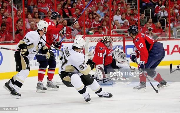 Mike Green Simeon Varlamov and Nicklas Backstrom of the Washington Capitals stop a scoring attempt by Sidney Crosby and Craig Adams of the Pittsburgh...