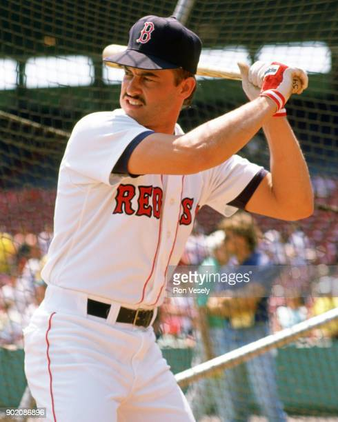 Mike Greenwell of the Boston Red Sox hits in the batting cage prior to an MLB game at Fenway Park in Boston Massachusetts during the 1989 season