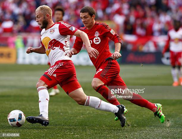 Mike Grella of New York Red Bulls drives by Will Johnson of Toronto FC during their match at Red Bull Arena on March 6 2016 in Harrison New Jersey