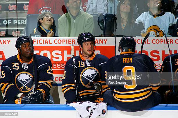 Mike Grier and Tim Connolly of the Buffalo Sabres looks on from the bench area during a break in NHL game action against the Montreal Canadiens at...