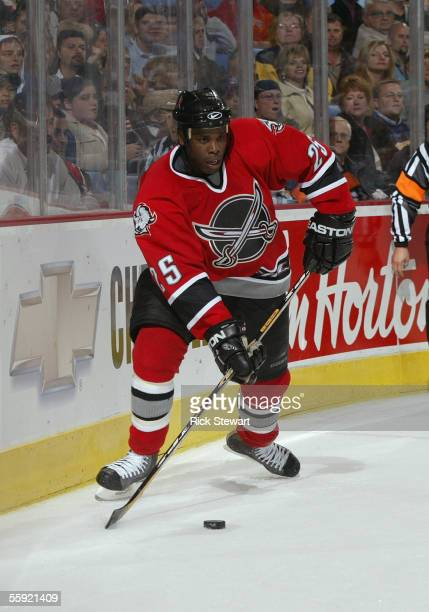 Mike Grier of the Buffalo Sabres looks to make a centering pass from behind the net against the Boston Bruins on October 7, 2005 at HSBC Arena in...