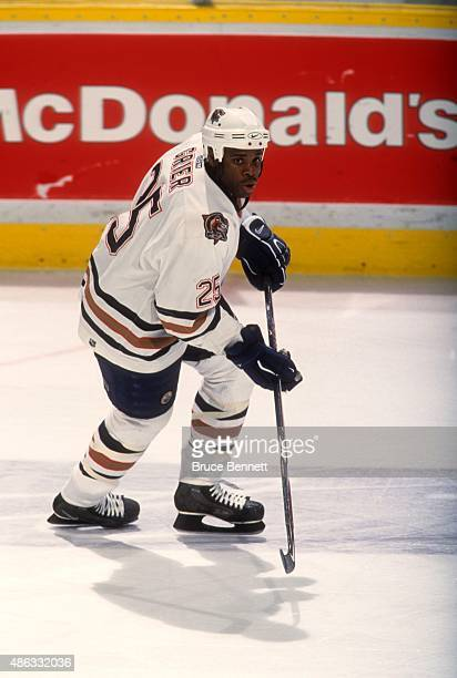 Mike Grier of the Edmonton Oilers skates on the ice during an NHL game in April 2001 at the Rexall Place in Edmonton Alberta Canada
