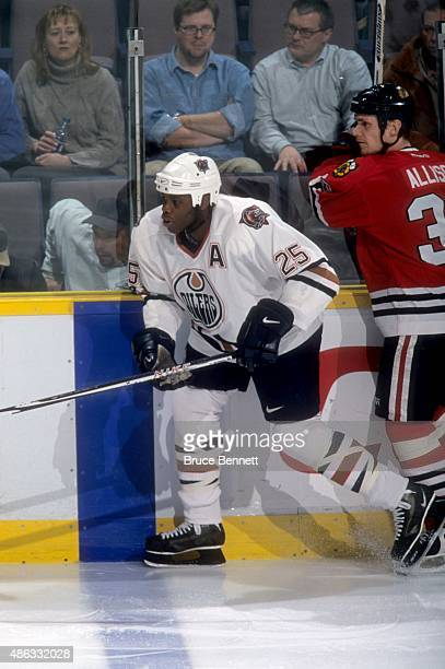 Mike Grier of the Edmonton Oilers skates on the ice during an NHL game against the Chicago Blackhawks on January 31 2001 at the Rexall Place in...