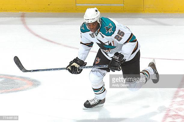 Mike Grier of the San Jose Sharks chases down the puck during a game against the Edmonton Oilers on October 4 2007 at Rexall Place in Edmonton...