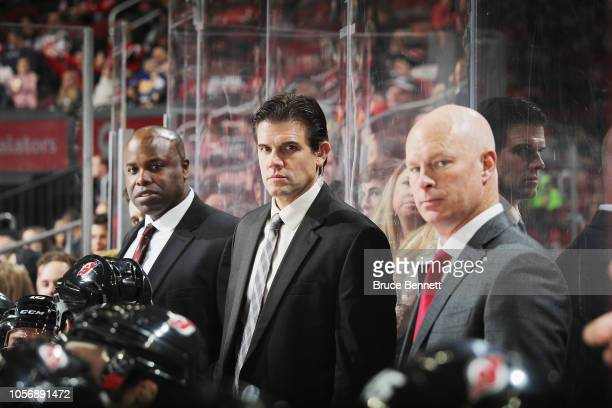 Mike Grier Rick Kowalsky and John Hynes of the New Jersey Devils work the game against the Colorado Avalanche at the Prudential Center on October 18...