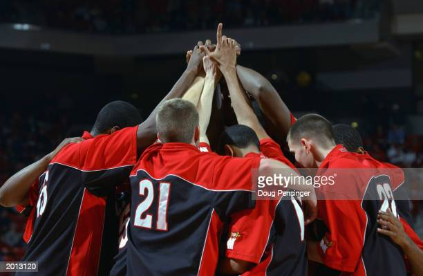 Mike Grinnon huddles with his University of Maryland Terrapins before the NCAA basketball game against the Citadel Bulldogs at the Comcast Center on...
