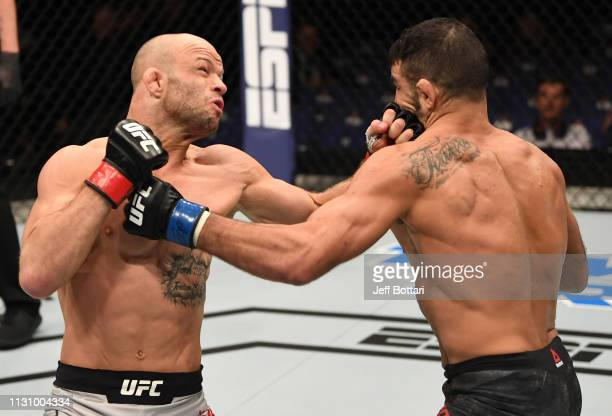 Mike Grundy of England and Nad Narimani of England trade punches in their featherweight bout during the UFC Fight Night event at The O2 Arena on...