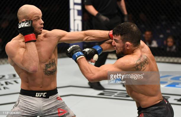 Mike Grundy of England punches Nad Narimani of England in their featherweight bout during the UFC Fight Night event at The O2 Arena on March 16 2019...