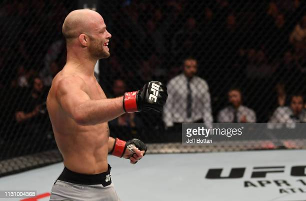Mike Grundy of England reacts after his TKO victory over Nad Narimani of England in their featherweight bout during the UFC Fight Night event at The...