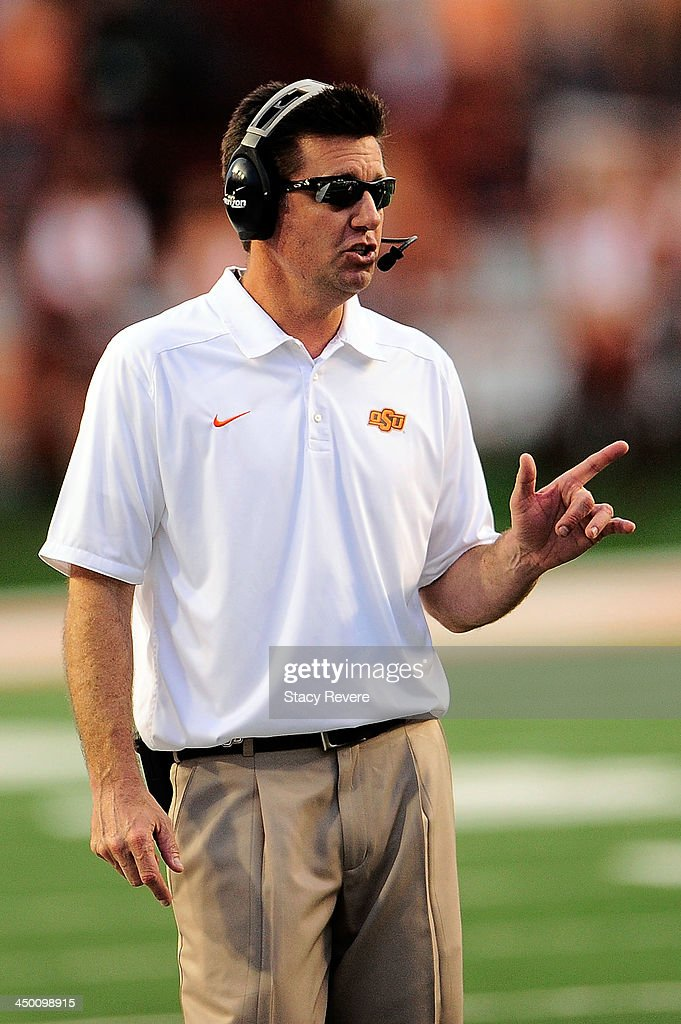 Mike Gundy, head coach of the Oklahoma State Cowboys, calls a play against the Texas Longhorns during a game at Darrell K Royal-Texas Memorial Stadium on November 16, 2013 in Austin, Texas. Oklahoma State won the game 38-13.