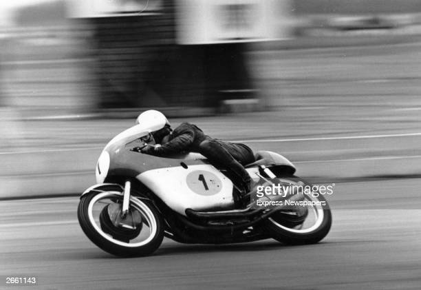 Mike Hailwood seen here riding at speed on his MV Agusta motorbike at Brands Hatch.