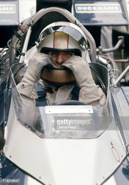 Mike Hailwood sits aboard the Team SurteesBrooke Bond OxoRob Walker Racing Surtees TS14A Ford Cosworth DFV 30 V8 before the start of the VIII Daily...