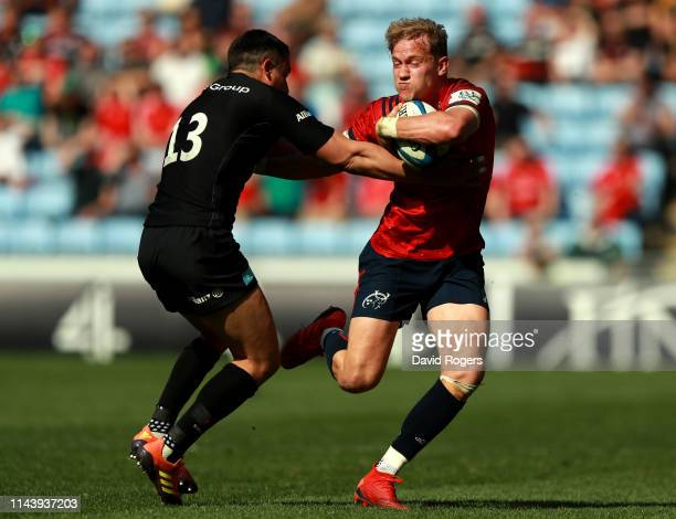 Mike Haley of Munster Rugby is tackled by Alex Lozowski of Saracens during the Champions Cup Semi Final match between Saracens and Munster at Ricoh...