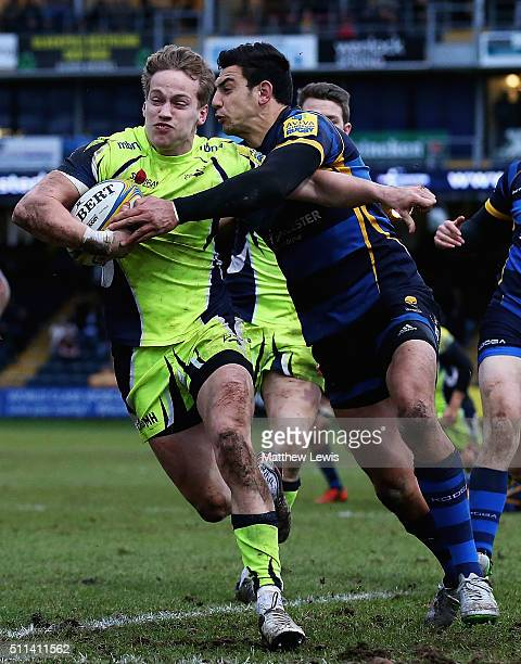 Mike Haley of Sale Sharks holds off Bryce Heem of Worcester Warriors to score a try during the Aviva Premiership match between Worcester Warriors and...