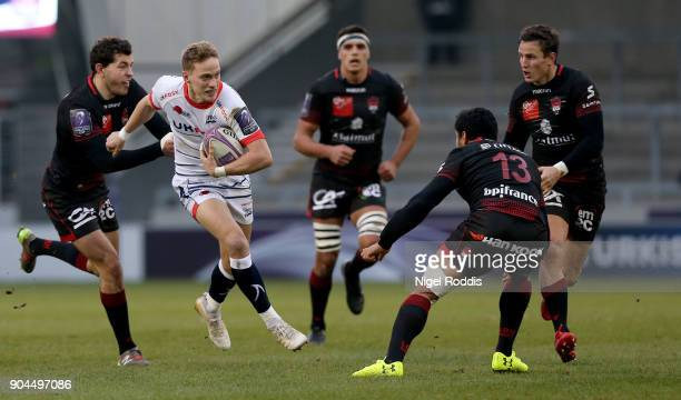 Mike Haley of Sale Sharks tackled by JeanMarcellin Buttin and Rudi Wolf of Lyon during the European Rugby Challenge Cup match between Sale Sharks and...