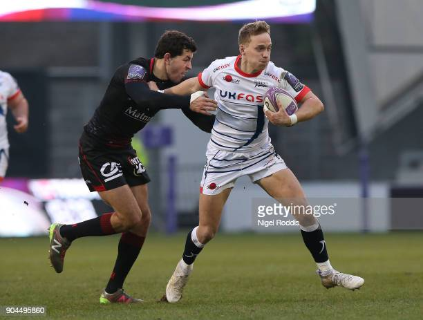 Mike Haley of Sale Sharks tackled by JeanMarcellin Buttin of Lyon during the European Rugby Challenge Cup match between Sale Sharks and Lyon at the...