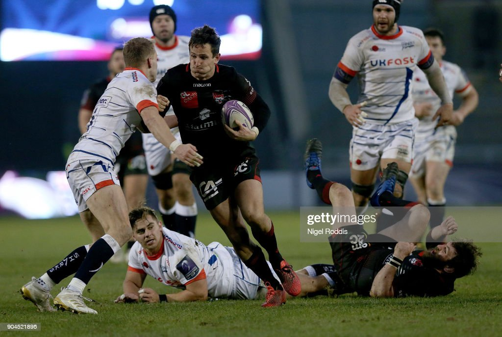 Mike Haley (L) of Sale Sharks tackles Mike Harris of Lyon during the European Rugby Challenge Cup match between Sale Sharks and Lyon at the AJB Stadium on January 13, 2018 in Salford, United Kingdom.