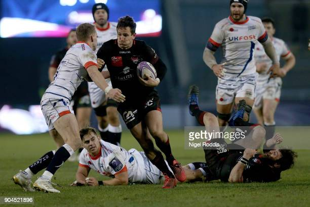 Mike Haley of Sale Sharks tackles Mike Harris of Lyon during the European Rugby Challenge Cup match between Sale Sharks and Lyon at the AJB Stadium...