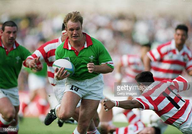 Mike Hall of Wales uses his pace to charge through during the 1995 Rugby World Cup Pool C match between Japan and Wales held on May 27 1995 at the...