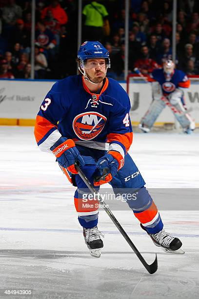 Mike Halmo of the New York Islanders skates against the New Jersey Devils at Nassau Veterans Memorial Coliseum on March 29, 2014 in Uniondale, New...