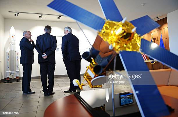 Mike Hamel vice president and general manager of Commercial Space at Lockheed Martin left Colorado Gov John Hickenlooper center and Rick Ambrose...