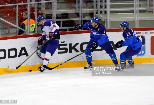 Mike Hammond of Great Britain competes for the puck with Armin Hofer of Italy and Alex Lambacher of Italy during the 2018 IIHF Ice Hockey World...