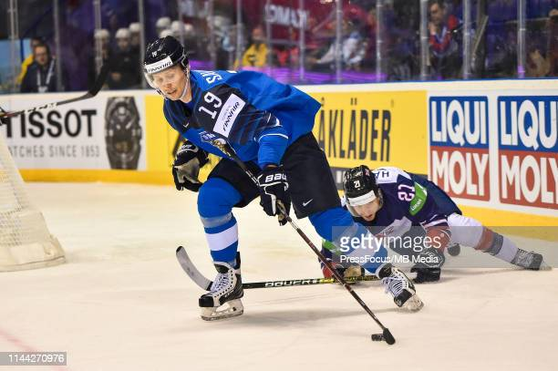 Mike Hammond of Great Britain tackles Juhani Tyrvainen of Finland during the 2019 IIHF Ice Hockey World Championship Slovakia group A game between...