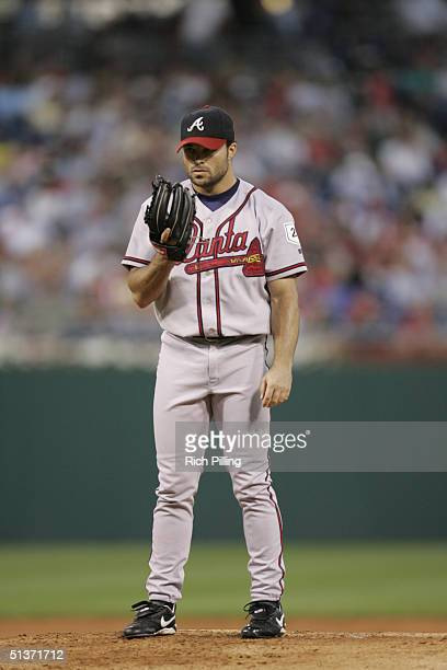 Mike Hampton of the Atlanta Braves sets up for the pitch during the game against the Philadelphia Phillies at Citizens Bank Park on August 31 2004 in...