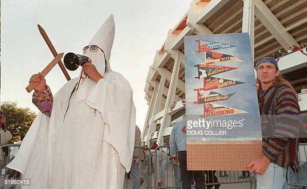 Mike Haney a Native American from Cleveland Ohio and dressed like a member of the white supremcist organization Ku Klux Klan demonstrates outside...