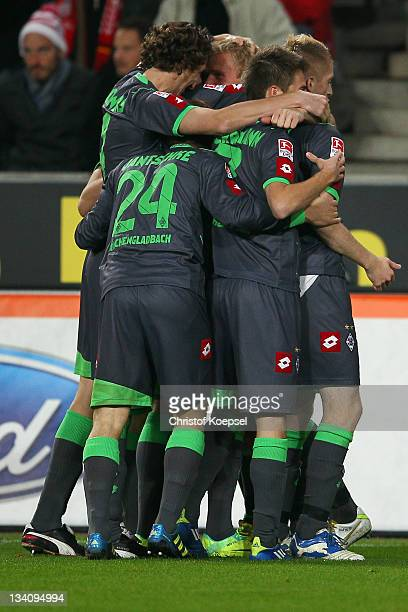 MIke Hanke celebrates the third goal with his team mates during the Bundesliga match between 1. FC Koeln and Borussia Moenchengladbach at...