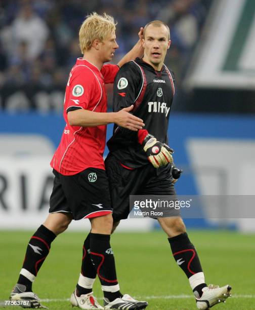 Mike Hanke comforts Robert Enke goalkeeper of Hanover looks dejected during the DFB Cup second round match between Schalke 04 and Hanover 96 at the...