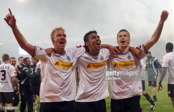 Mike Hanke Igor de Camargo and Marco Reus of Moenchengladbach celebrate after the Bundesliga play off second leg match between VfL Bochum and...