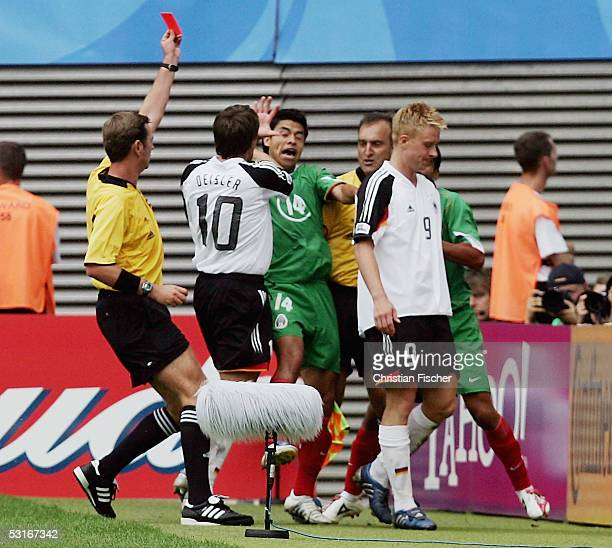 Mike Hanke of Germany gets the red card from referee Matthew Breeze near a infight between Sebastian Deisler of Germany and Gonzalo Pineda of Mexico...
