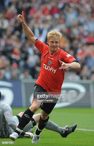 Mike Hanke of Hannover celebrates scoring his goal during the Bundesliga match between Hannover 96 and Hertha BSC Berlin at the AWD Arena on April...