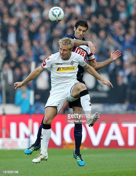 Mike Hanke of Moenchengladbach and Andre Mijatovic of Berlin jump for a header during the Bundesliga match between Hertha BSC Berlin and Borussia...