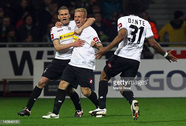 Mike Hanke of Moenchengladbach celebrate with his team mates after he scores his team's 2nd goal during the Bundesliga match between SV Werder Bremen...